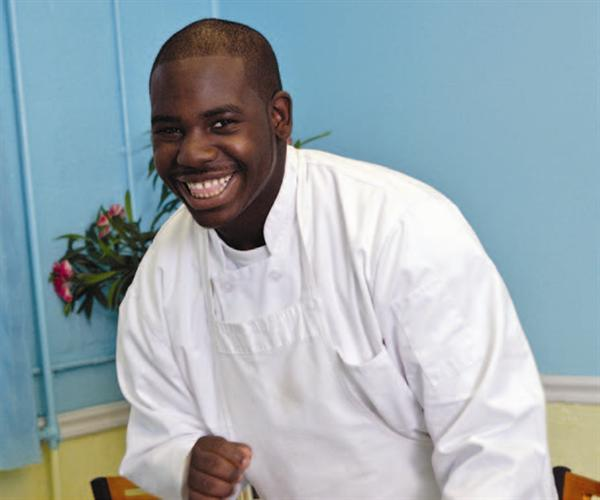 Culinary Student Smiles at Camera