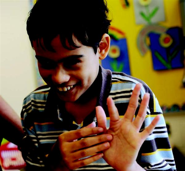 Boy waves at camera